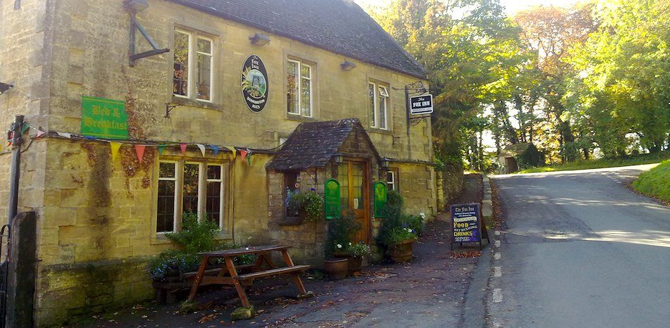 The Fox Inn, Great Barrington near Burford in Oxfordshire. Probably the best best REAL pub in the Cotswolds, old beams, log fires and set on the banks of the river Windrush.