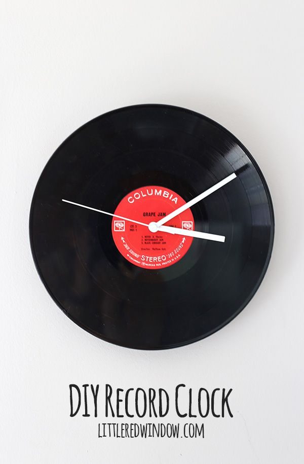 Make Your Own Record Clock From An Old Lp A Couple Weekends Ago We Completely Rearranged Re Did Our Basement Record Clock Vinyl Record Projects Record Crafts