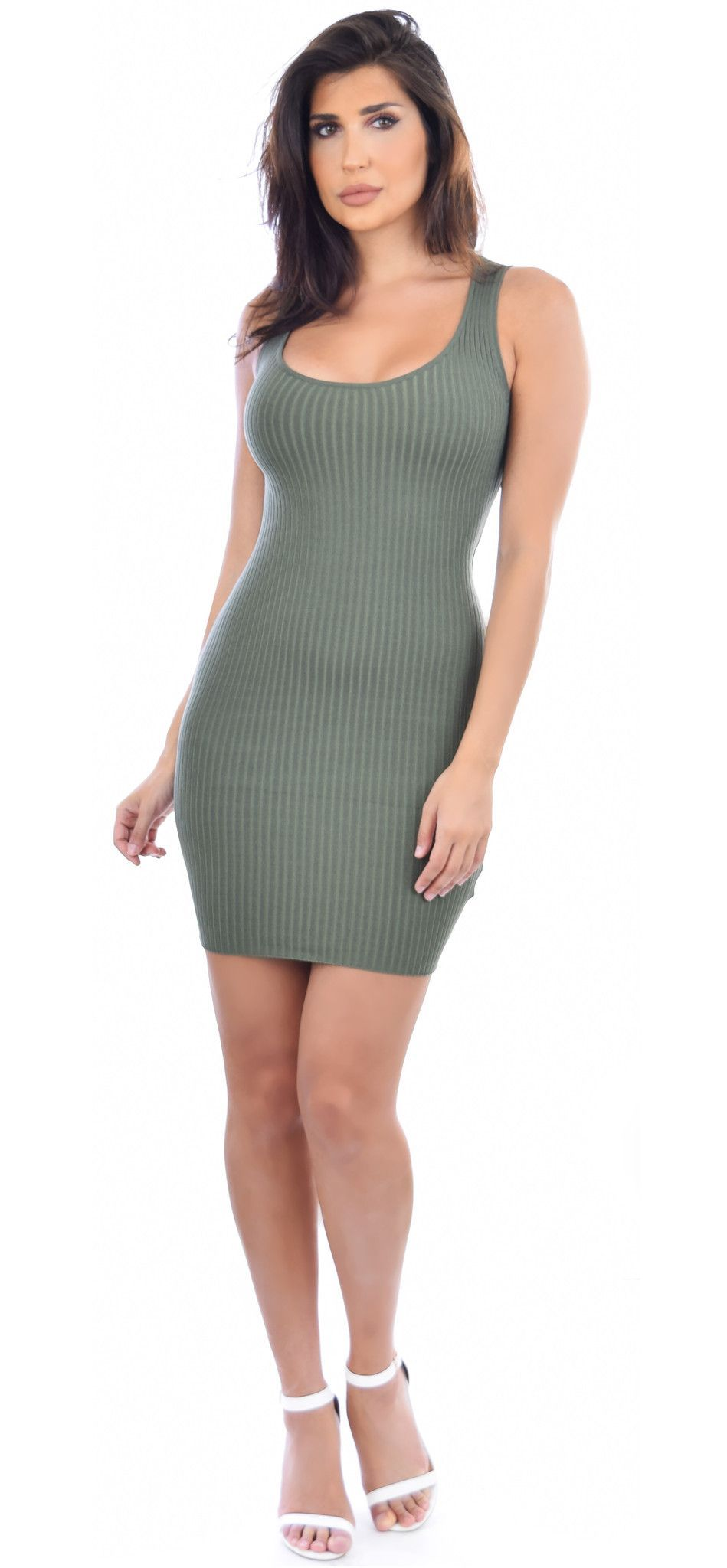"""- 70% Rayon, 30% Nylon - Mini length - Cross back design - Stretchy - Ribbed - Round neckline - Unlined - No closure Model is 5'8"""" and is wearing a size Small Models Measurements: - Bust: 36C Waist: 2"""