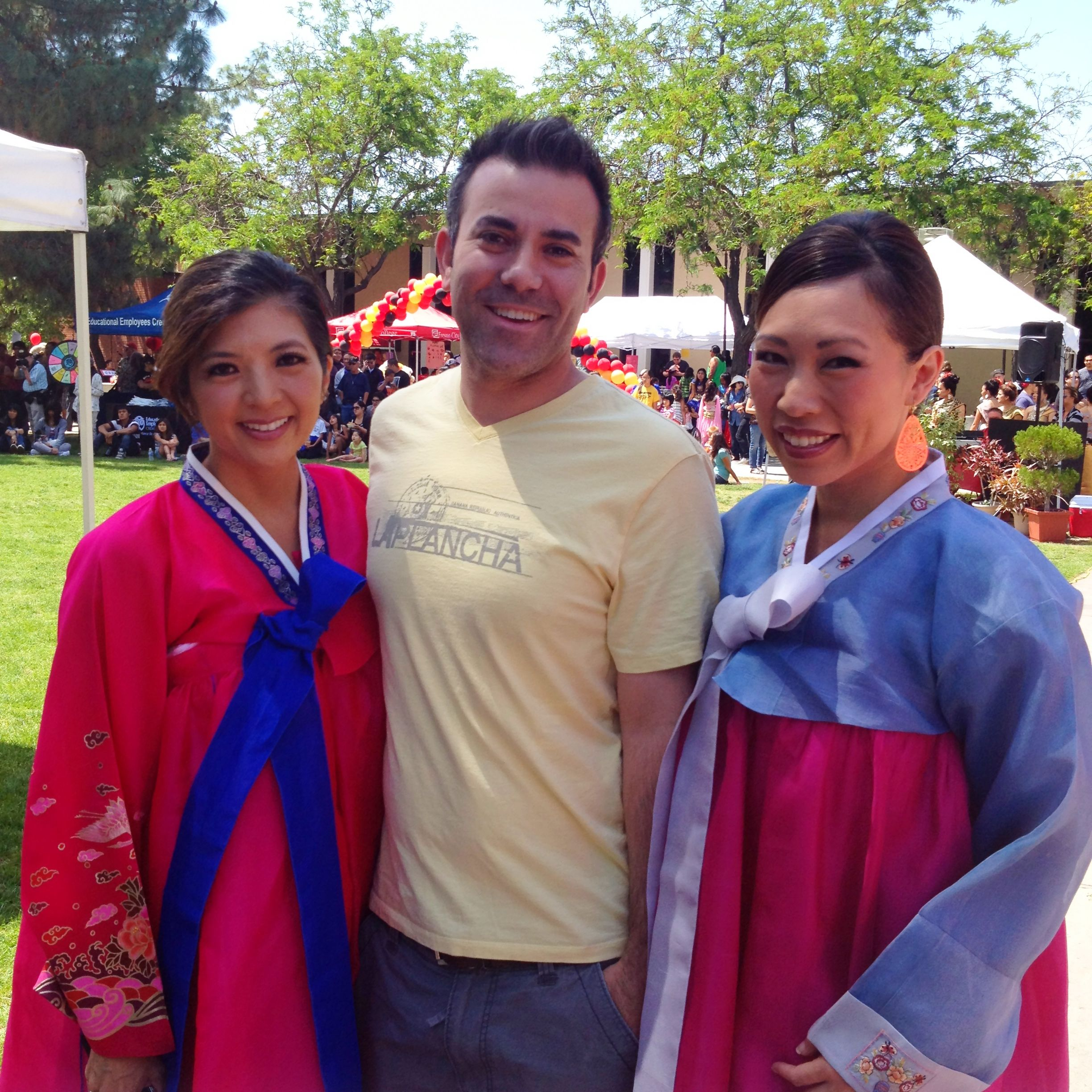 Jason Oliveira joins his co-anchors, Margot Kim and Christine Park wearing hanboks (Traditional Korean dresses) as emcees of Fresno City College's Asian Fest.