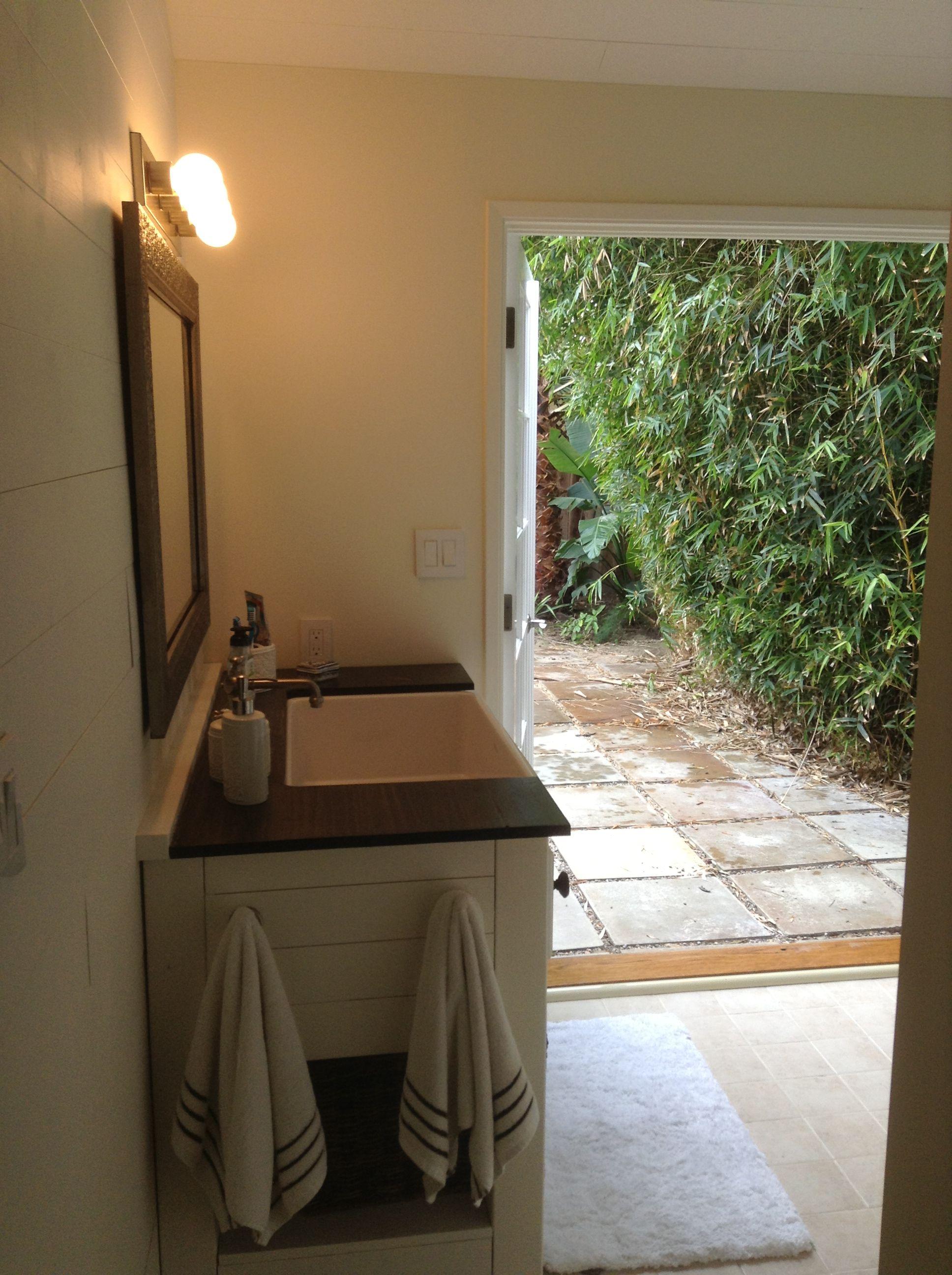 opened french doors to backyard indooroutdoor bathroom