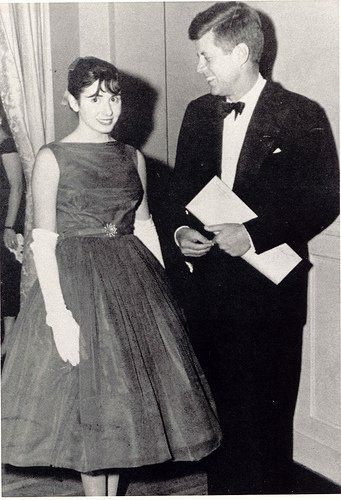 A young Nancy Pelosi, posing with President Kennedy on his Inauguration Day
