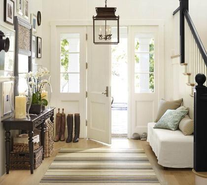 Bright hallway, wooden floors.