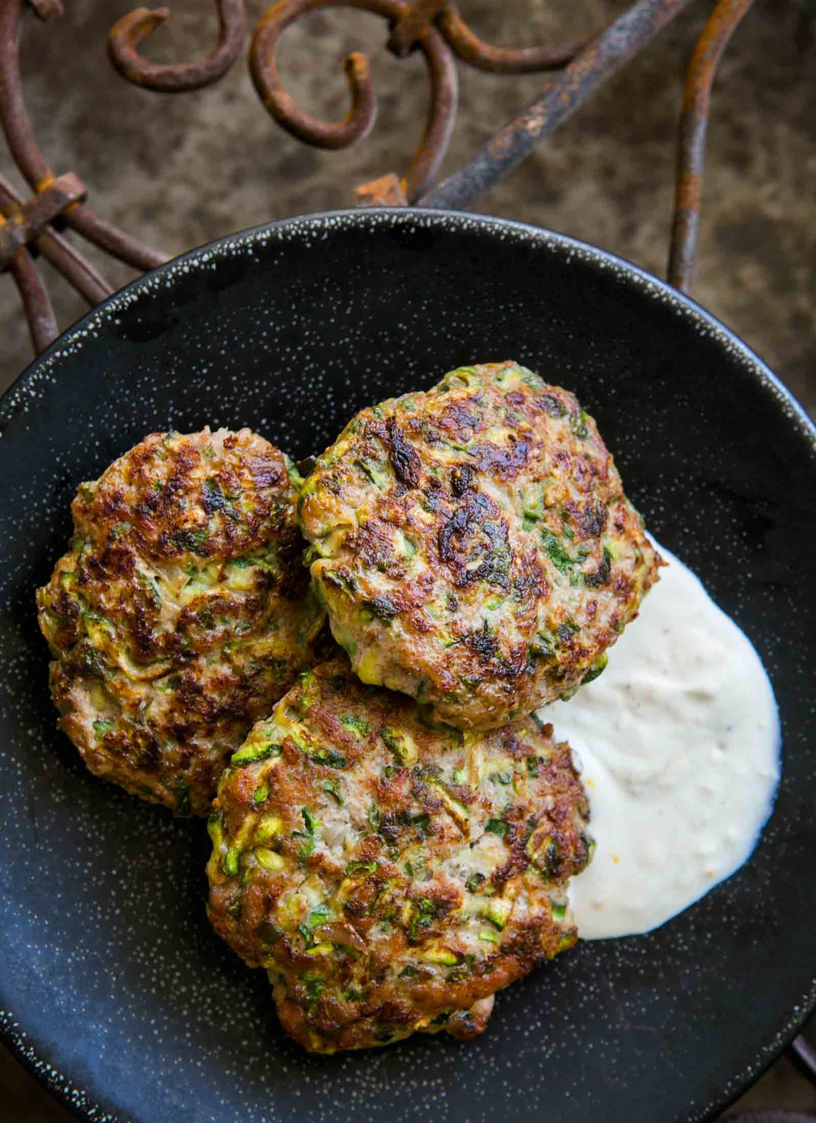 Spicy Turkey and Zucchini Burger ~ Turkey burger patties with grated zucchini, herbs, cumin, and cayenne, served with lemony sour cream sauce. ~ SimplyRecipes.com #middleeastern #gluten-free #healthy #burger