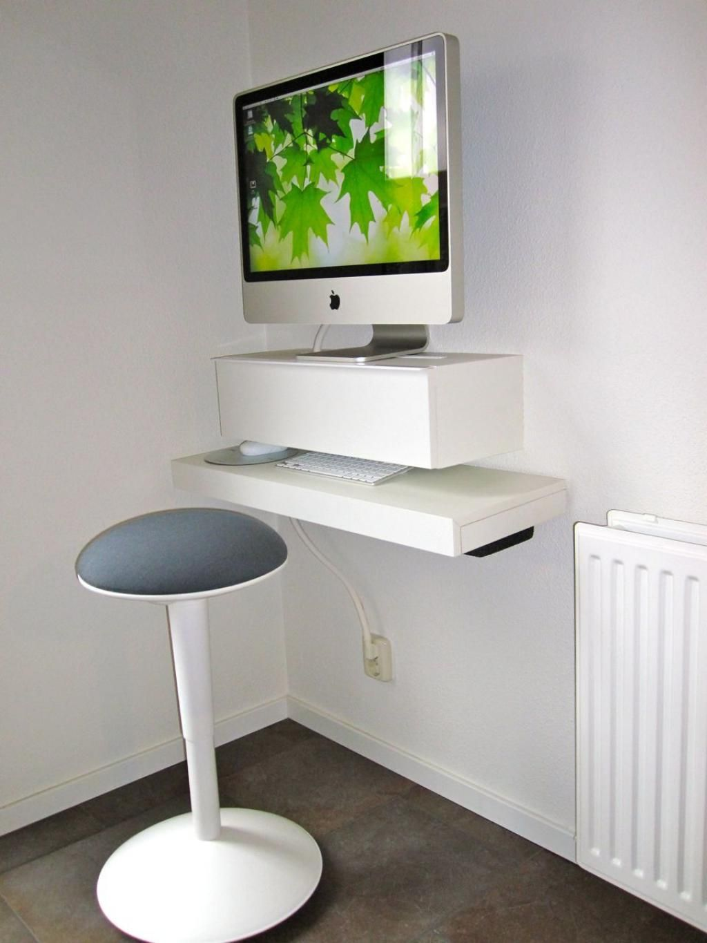 Wall mounted computer table designs - Round Bench Combined With Minimalist Wall Mount Computer Desk Feat White Heater On Home Office Creative