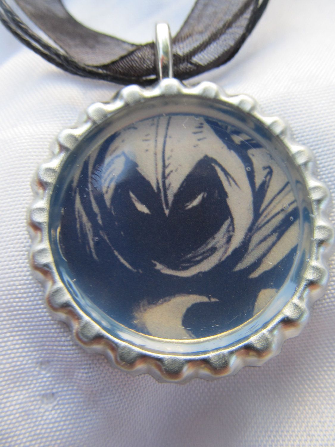 Marvel Comics' Moon Knight bottle cap necklace with organza cord - from a real comic book. $6.99, via Etsy.