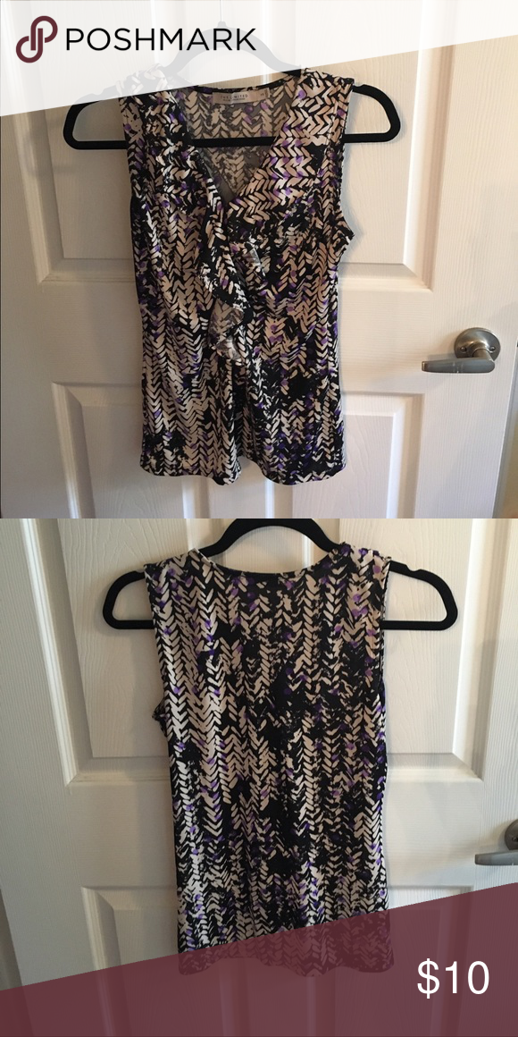 The limited sleeveless blouse Very comfortable fabric & can be dressed up or down The Limited Tops Blouses