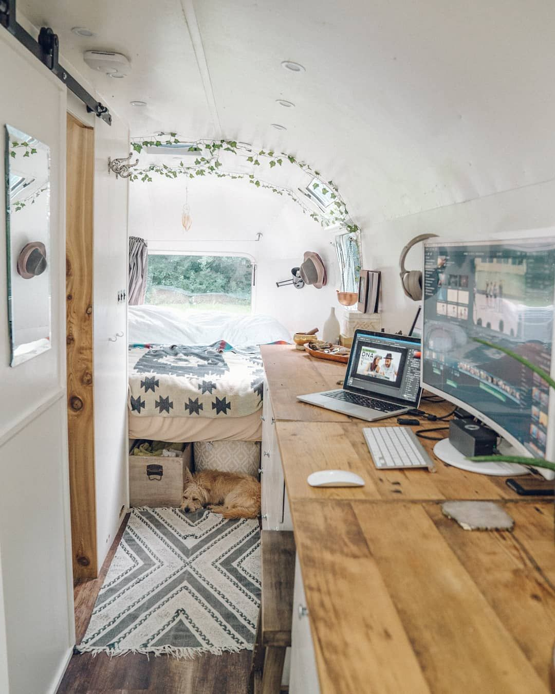 "Photo of Luna the Airstream on Instagram: ""A typical day in Luna. Edit videos for our YouTube channel and blog while @atlasadventurepup takes a nap after hours of playing on the beach.… """