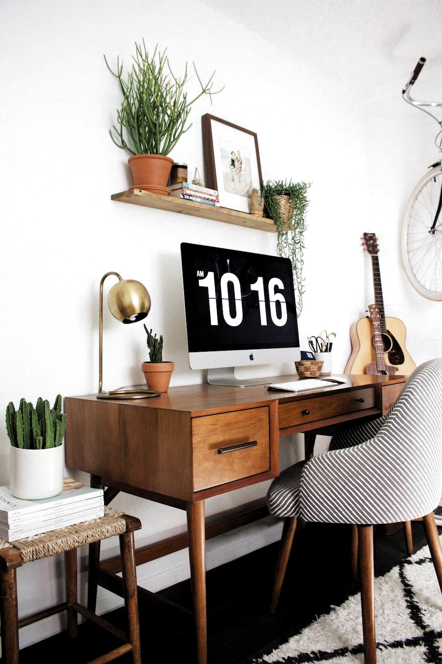 Mid-century modern desks don't have to be sourced from an antique shop or yard sale. Nowadays, the mid-century modern decorating style has become immensely popular. Many furniture makers have started creating beautiful mid-century modern inspired designs for all types of furniture, like office desks. This Mid-Century Modern Desk is from New Darlings blog. #apartmentdecor