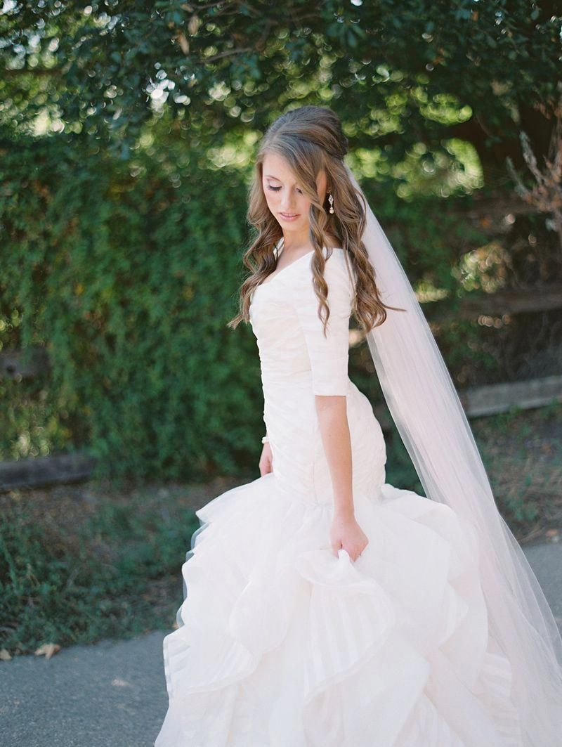 Best wedding dresses for short hair  modest wedding dress with elbow sleeves and a playful mermaid skirt