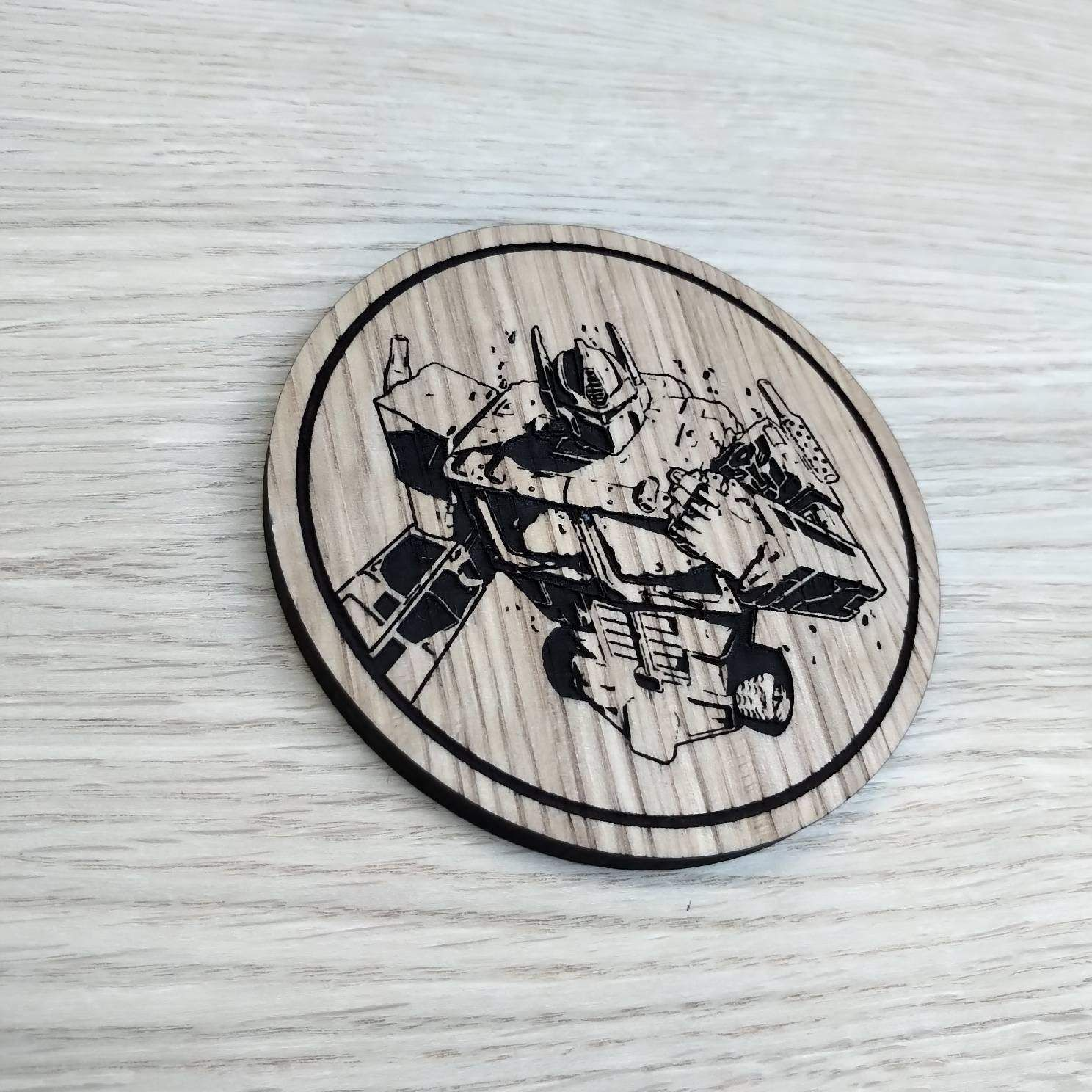 Laser cut wooden coaster. Optimus Prime torso. Fist clenched