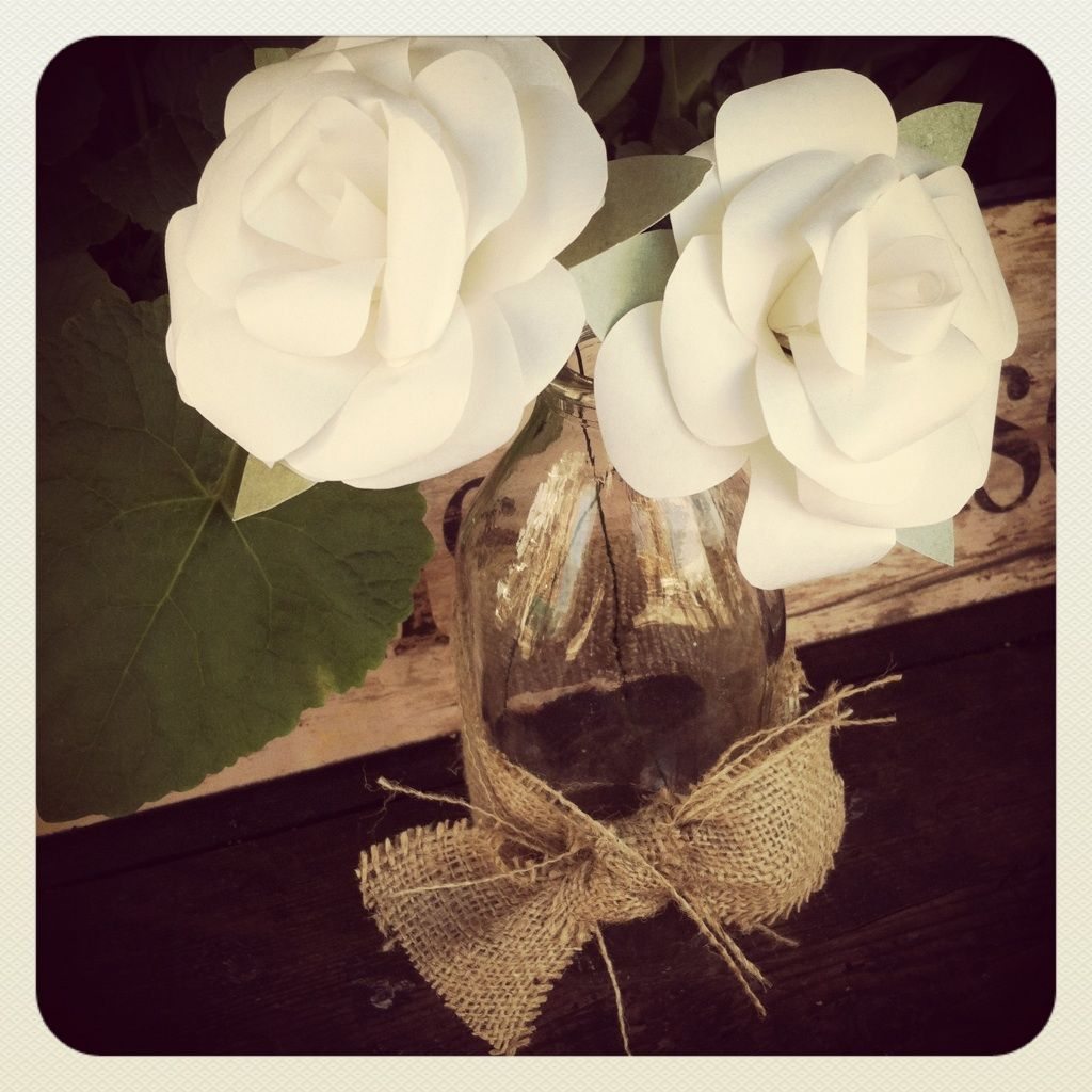 beautiful paper flowers in old milk bottles, with burlap bows