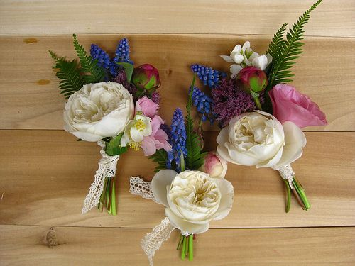 white garden rose boutonniere corsage with grape hyacinth