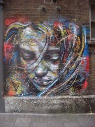 I want a graffiti wall in my house!  I really admire the depth and color of this piece.