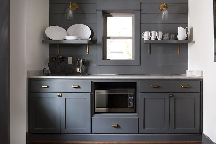 Dark gray butler pantry is fitted with dark gray shaker