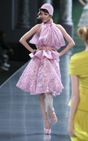 A model wears a pink creation by British fashion designer John Galliano for Dior's haute couture fall-winter 2008 collection show in Paris.