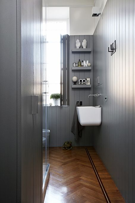 bathroom: grey timber panelling/matching window shutters and timber floor