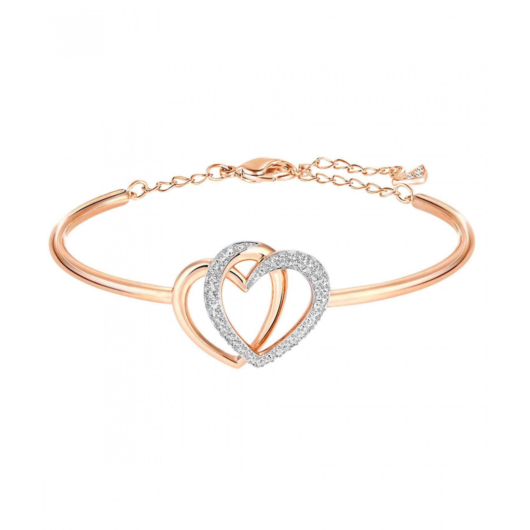 2e6cbd8243a863 Pulsera Swarovski de la colección Dear en baño de oro rosa con diseño de  corazones entrelazados y aplicación de cristales.