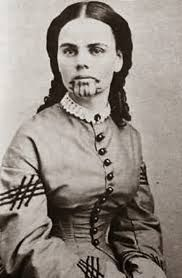 She was captured by native americans and sold to another tribe who adopted and tattooed her.