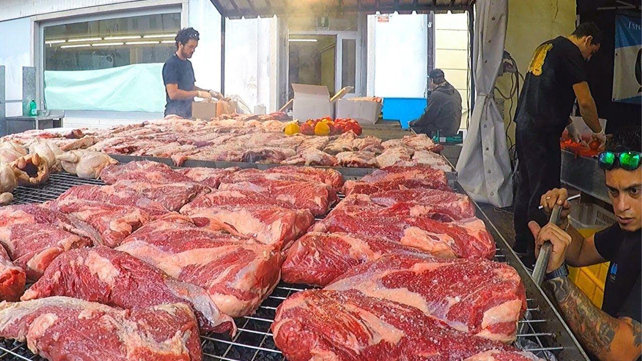 Argentina street food huge grills of juicy ribs sausages