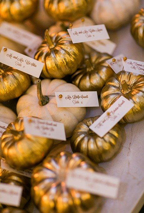 Escort card pumpkins in both pale tones and metallic gold contrast and combine for a perfectly neutral palette.