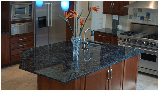 Attrayant Mirror Polished Blue Granite Countertop. Works Beautifully With The Dark  Natural Wood Of The Cabinets.