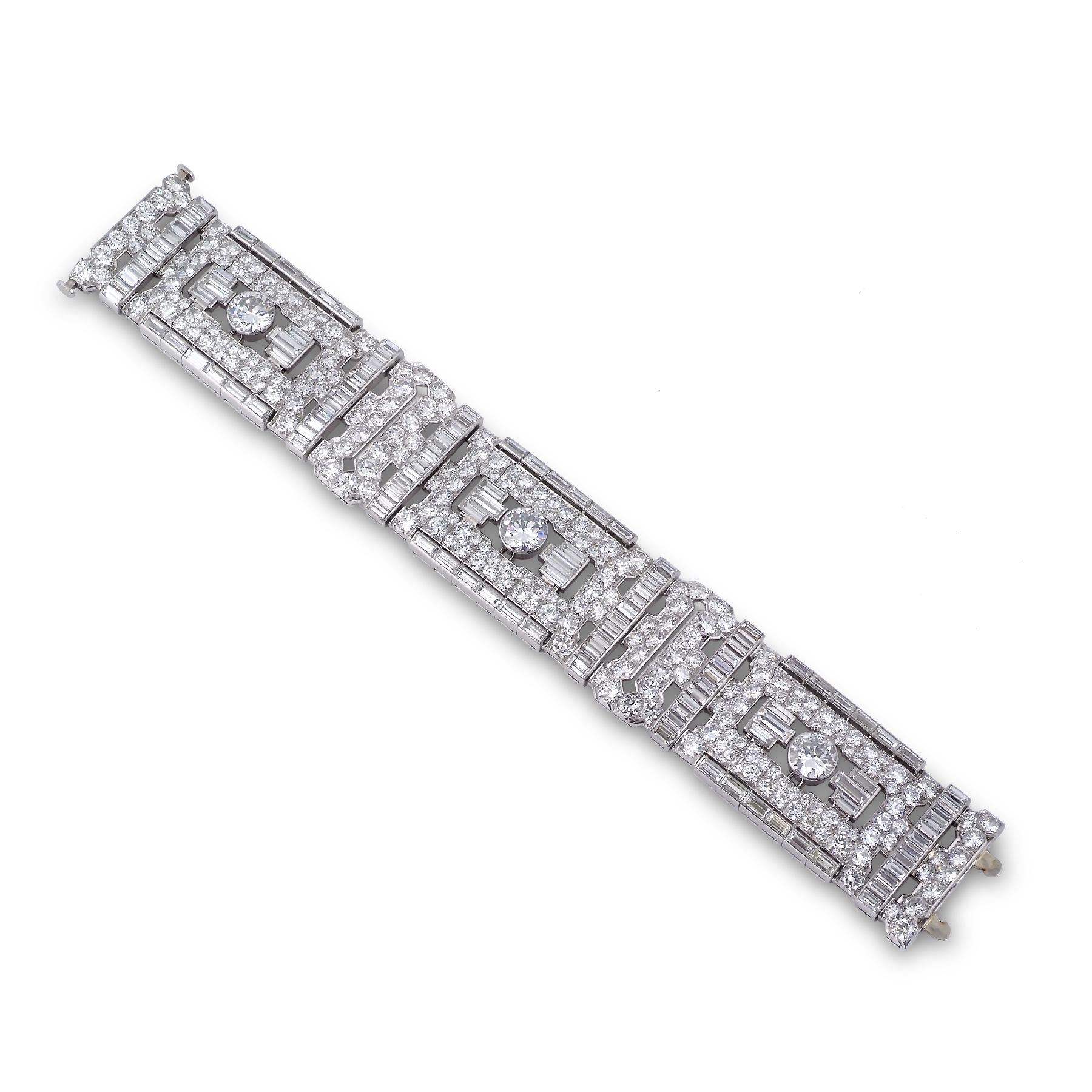 An Impressive Art Deco Diamond Bracelet Designed As Three Openwork Panels Each Set To The Centre With Circular Cut Within A Geometric Surround