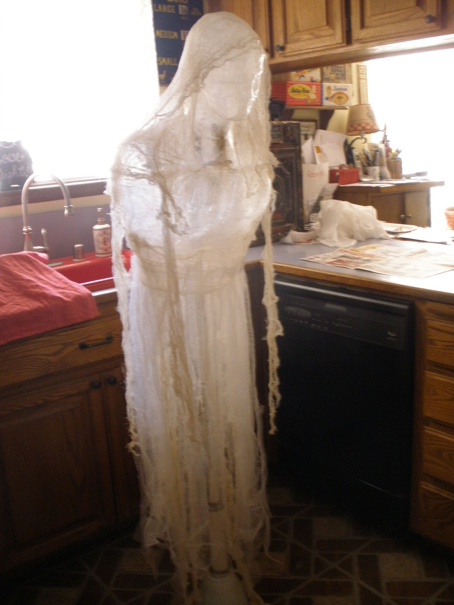 Packing tape/cheesecloth ghost to hang in trees Done for under 10 - Halloween Ghost Decorations