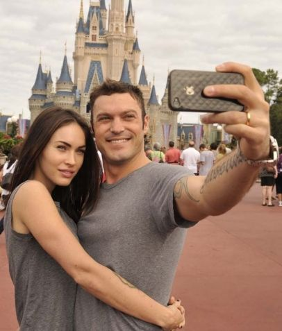 Actor Brian Austin Green and his wife, actress model Megan Fox take a souvenir photo in the Magic Kingdom in Lake Buena Vista, Fla.