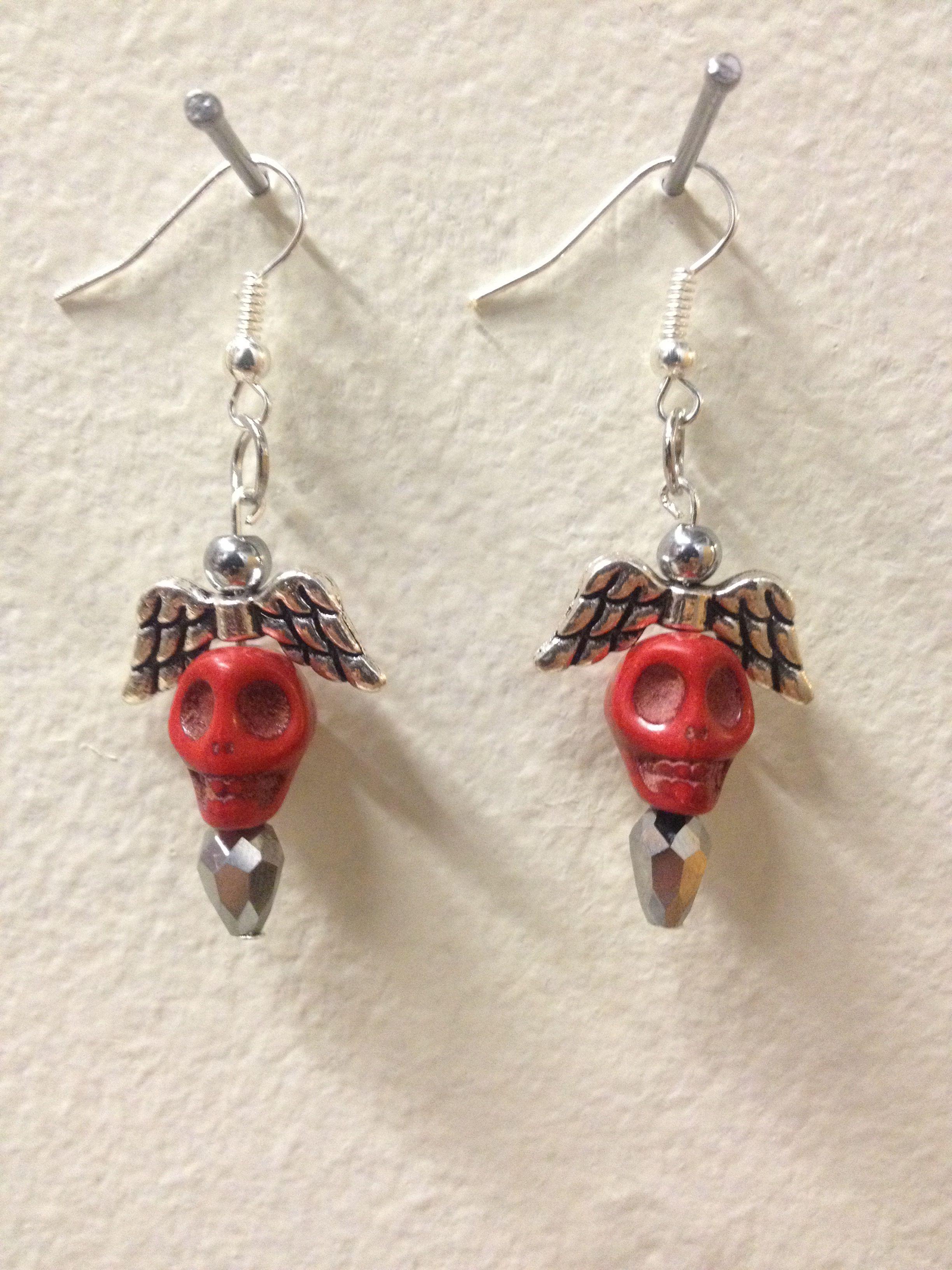 Drop earrings with red howlite skulls