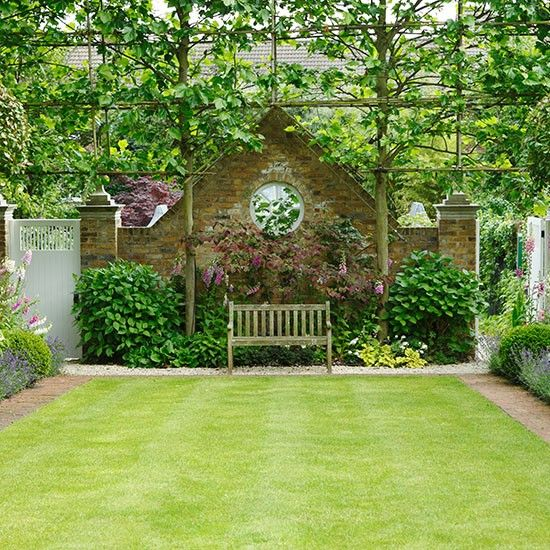 Maximized grass rectangle offers space for play, parties and contemplation with a classic English country effect with brick edging, tiered planting and pleached hedge.