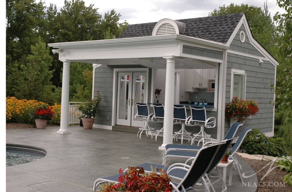 A nantucket inspired pool house provides easy access to a for Pool house plans with bathroom