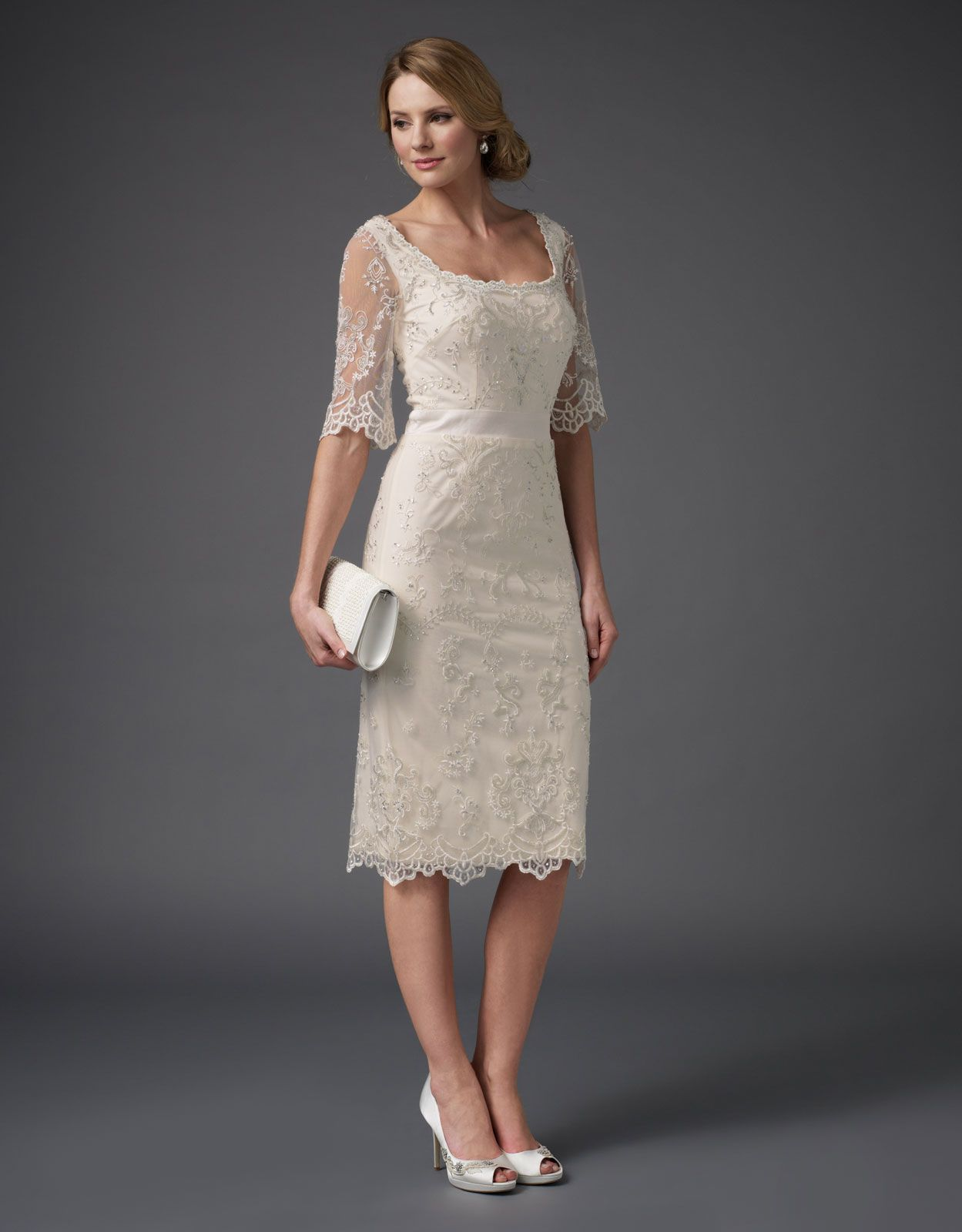 This ivory sheath dress with tulle and beautiful embroidery is very ...