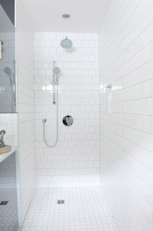 Relatively Walk-in shower features walls clad in white square tiles set in  PD24