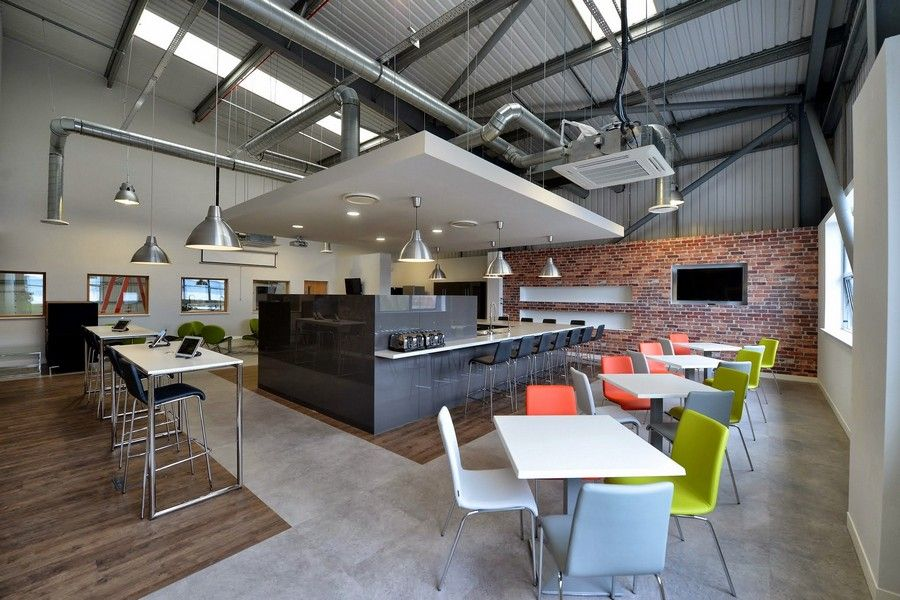 Break out and dining space in manchester with industrial for Industrial office interior