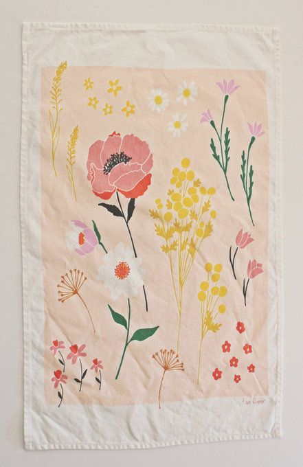 I have this pretty tea-towel by Lisa Rupp; I love to see the burst of summer as it hangs from the oven handle!