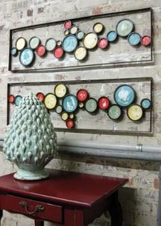 Wall Art.   Looks like used paint can lids mounted to a frame