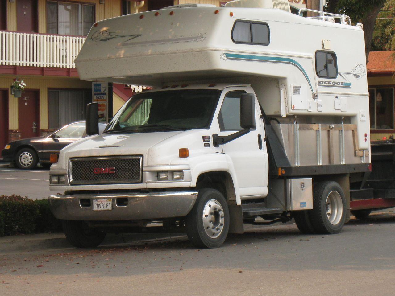 Big Gmc 4500 With Bigfoot Camper Truck Camper Truck Camping Trucks