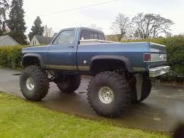 Old school lifted Chevy sitting high in the sky!