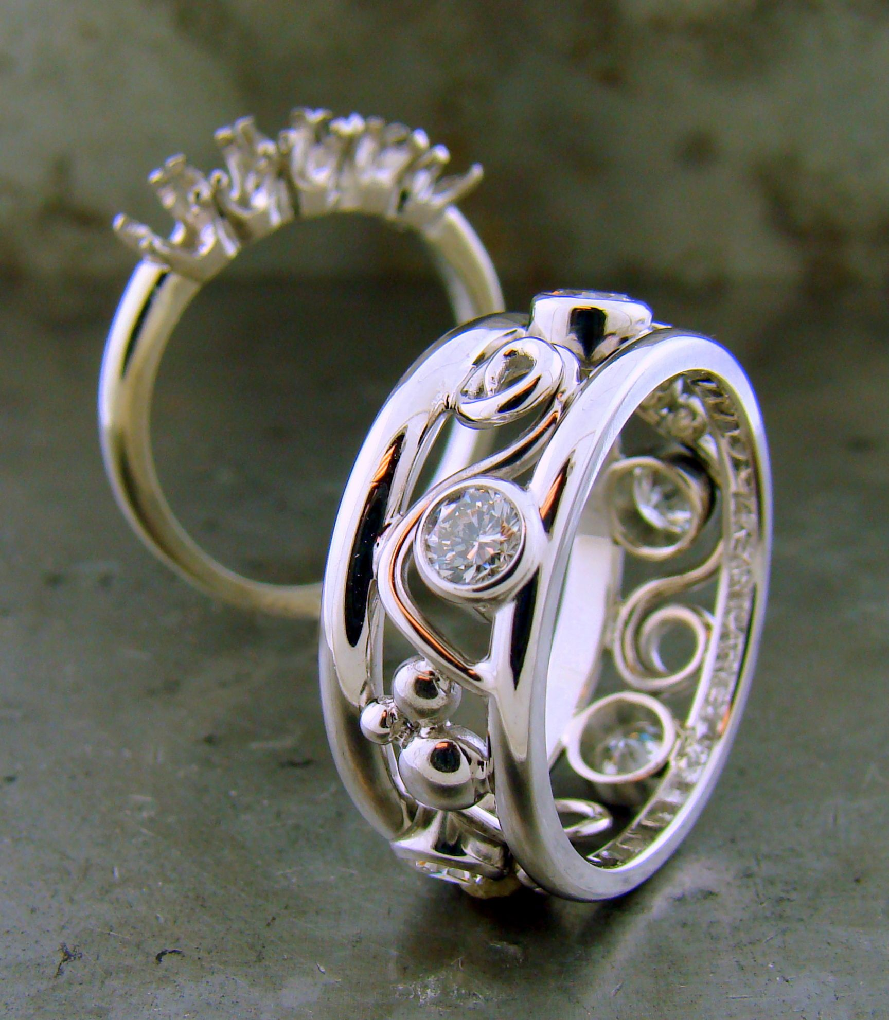 We remounted Patsy's 5 diamonds from her old ring to