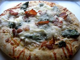 Roasted garlic and spinach pizza... can't wait to try this!