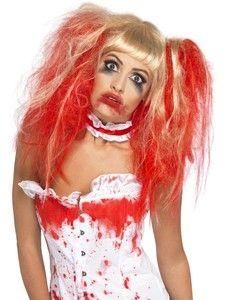 Zombie peruukki. Vaalea-punainen peruukki jossa on ponihännät sivuilla. Täydennä peruukkia keinoverellä.