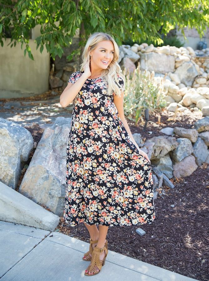 The Emery Black Floral Dress is everything you are looking for with comfort and style. This cozy dress features pinks and plenty of greenery.