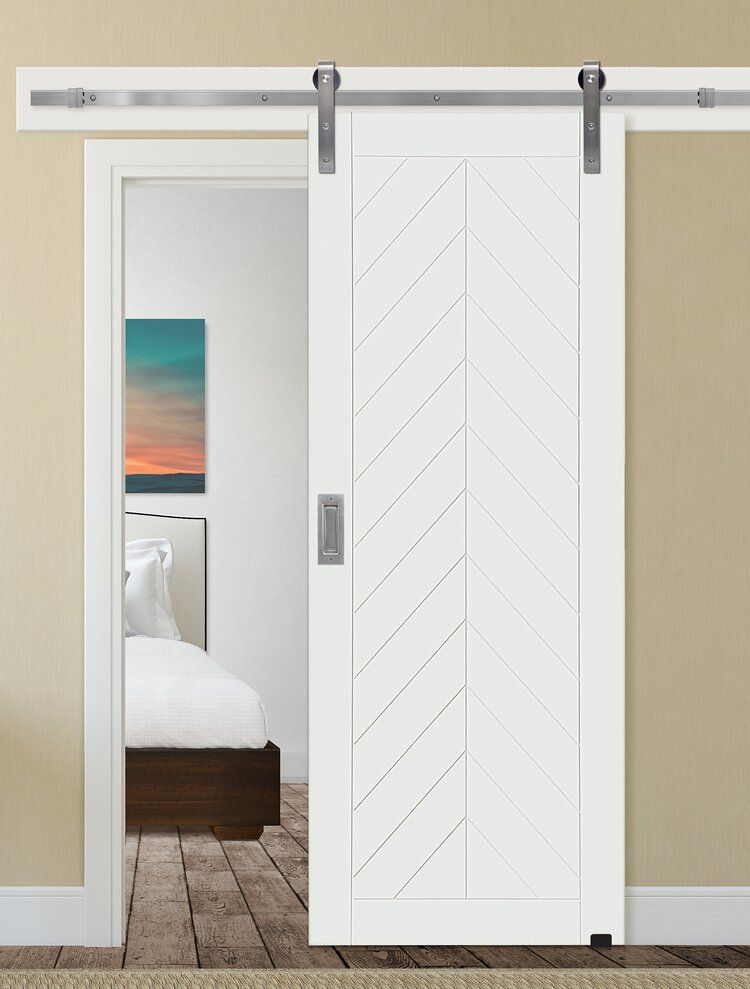 Paneled Manufactured Wood Primed Chevron Barn Door Without Installation Hardware Kit In 2020 Barn Doors Sliding Interior Barn Doors Sliding Barn Door Hardware