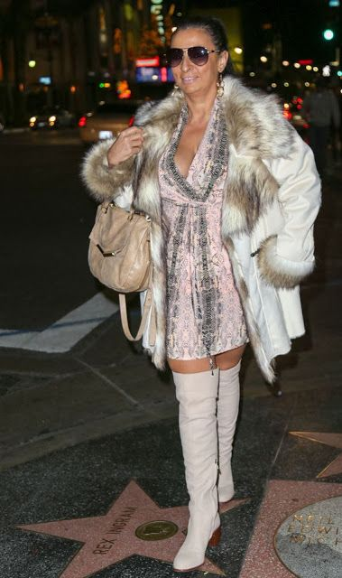 Alice Amter Wears A White Leather Coat Overknee Boots Leather