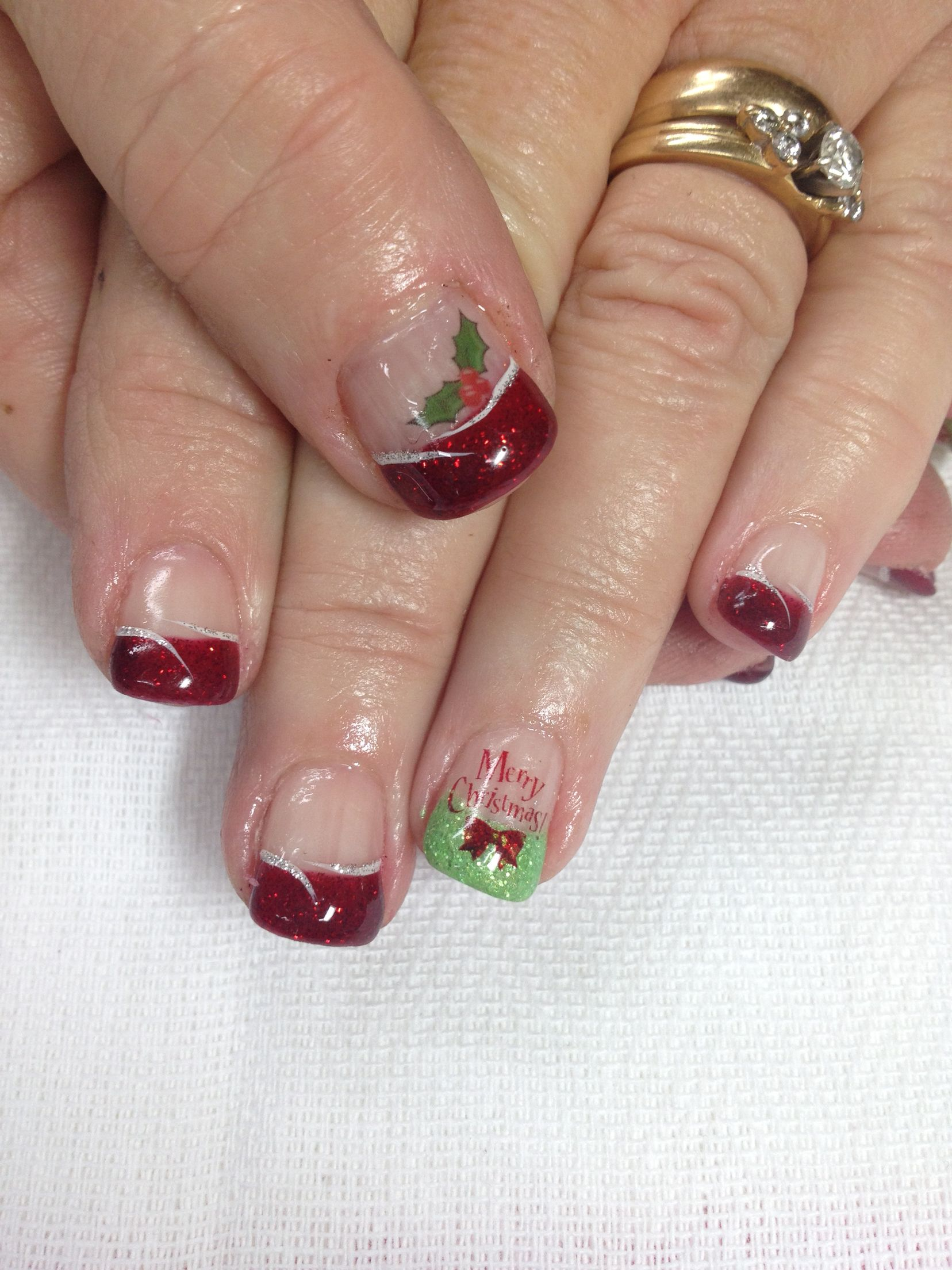 Red and green Christmas gel nails with holly and greeting. All done ...