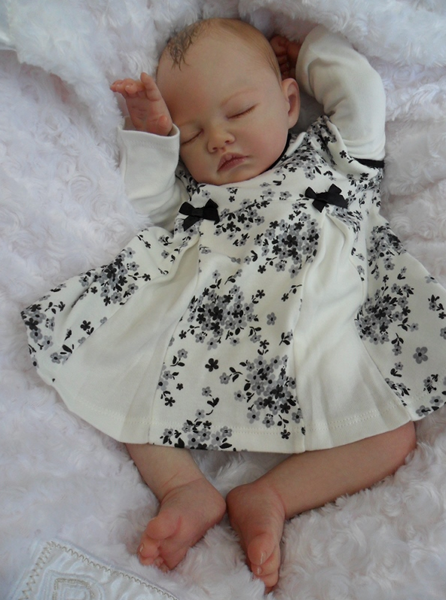 sleeping reborn baby doll are my moms favorite kind of
