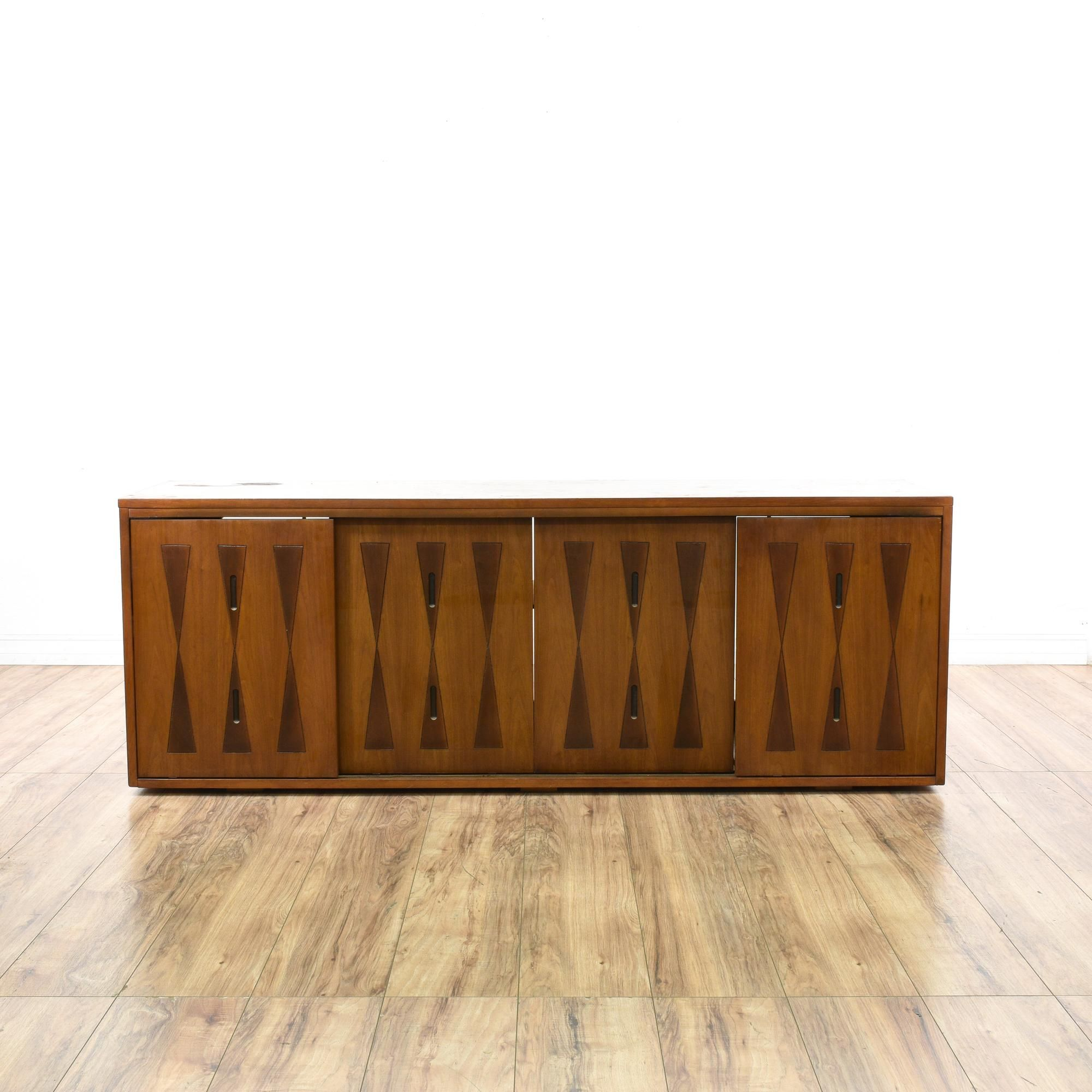This mid century modern media cabinet is featured in a solid wood