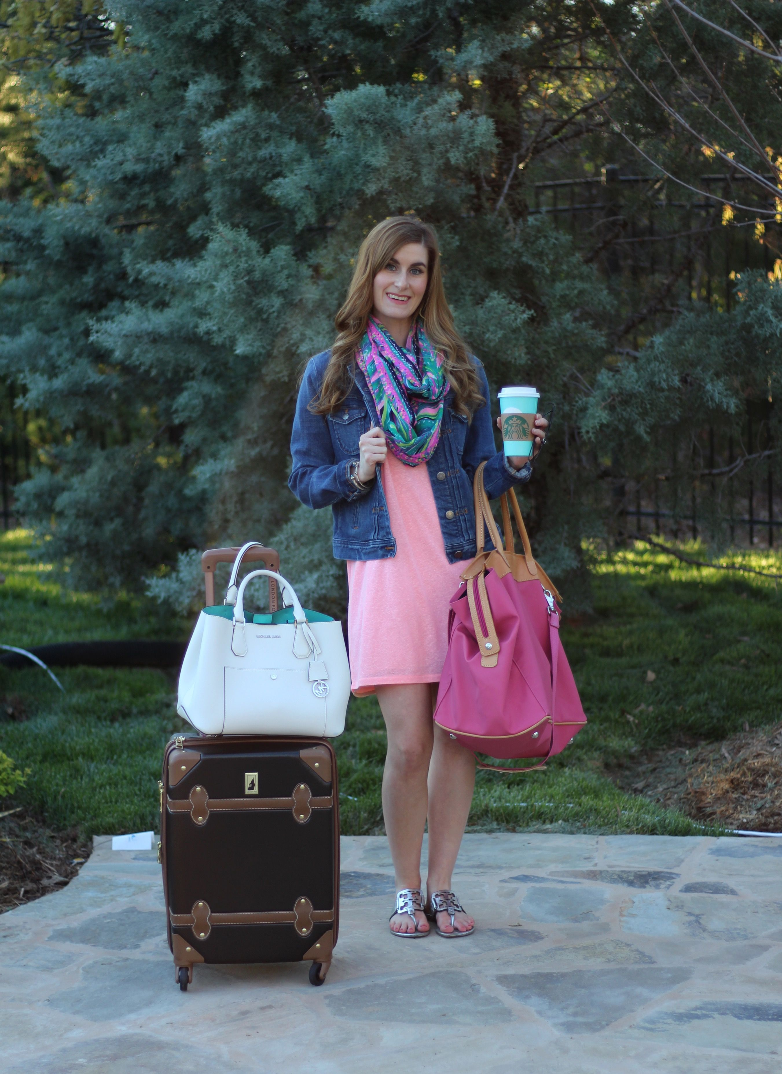 Pink dress with denim jacket  Traveling in comfort in style with a tshirt dress denim jacket and