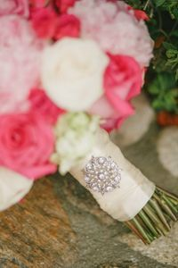 Berry Pink Peonies and Garden Roses Bouquet completed by diamond brooch